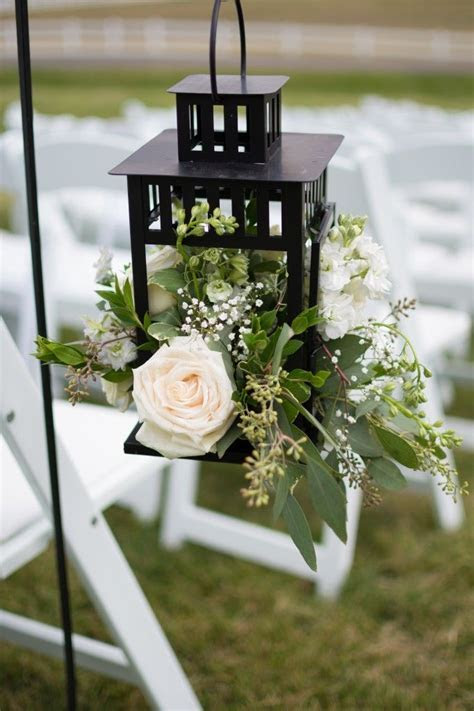 Hanging lanterns along the aisle adds a special touch to