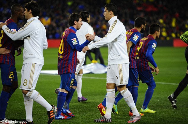 No eye contact: Ronaldo and Messi barely look at each other as they shake hands