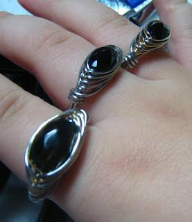 3 Herringbone Weave Rings with black onyx around fingers