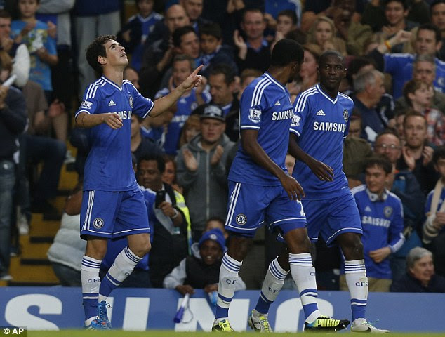 Back to winning ways: Oscar celebrates his goal - Chelsea's first in more than four hours of Premier League football