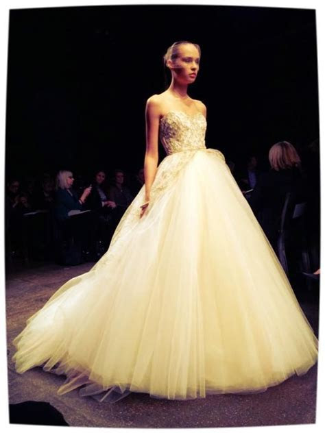 Sherbet colored ball gown with gold accents by Lazaro for
