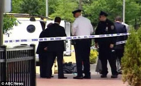 Police at the Hilton Garden Inn near Kennedy International Airport in Queens inspect the scene outside after Brian J. Weiss was killed by Gary L. Zalevsky who committed suicide soon after