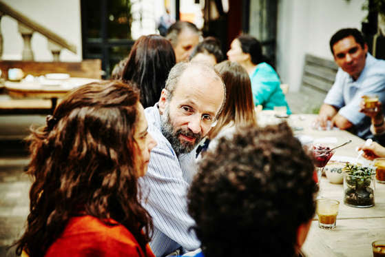 Man talking during family dinner.