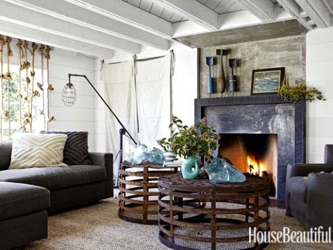 Unique Maritime Decor in a California Home via House Beautiful-knotted rope for curtains and salvaged metal baskets upside down for coffee tables