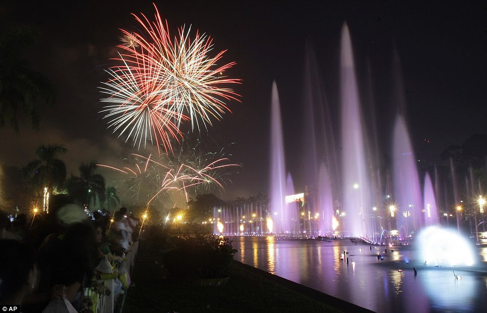 PHILIPPINES: A huge fireworks and water fountain display marks the New Year at Manila's Rizal Park