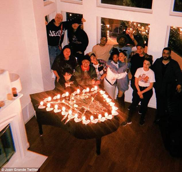 Surrounded by family: Ariana spent the anniversary of the Manchester Arena bombing with friends and family. This picture taken at their home on Tuesday evening wasposted by her mother Joan