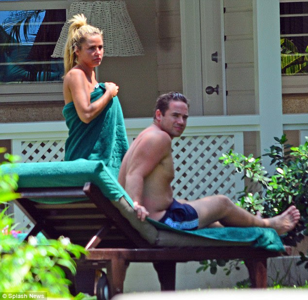 No fuss: But putting it all behind them, the couple looked like all was well as Katie walked around wearing nothing but a towel around herself as she wore her hair piled up on her head