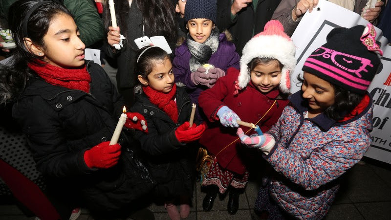 A Candlelight vigil for the children of Peshawar is held in Longsight, Manchester outside the Pakistani Community Centre. Image by Barbara Cook. Copyright Demotix (20/12/2014)