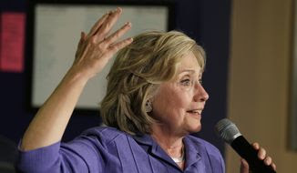 Democratic presidential candidate Hillary Rodham Clinton speaks during a campaign stop at Uncle Nancy's Coffee House, Sunday, Sept. 6, 2015, in Newton, Iowa. (AP Photo/Charlie Neibergall)
