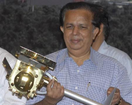 Chairman of the Indian Space Research Organisation (ISRO) G. Madhavan Nair, holds a miniature of India's first unmanned moon mission 'Chandrayaan-1' after its launch from the Satish Dhawan space centre at Sriharikota, about 100 km north of Chennai, October 22, 2008. REUTERS/Babu/Files