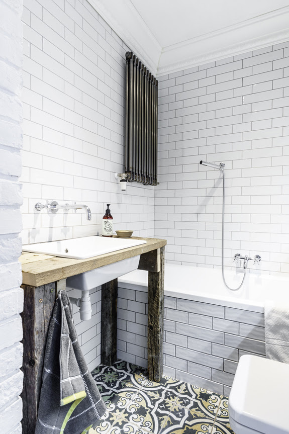 12 The second bathroom is industrial and rustic it reminds of the mid century decor