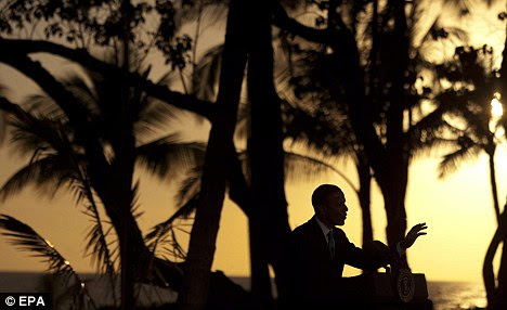 Winding down: Obama spoke to the media on Sunday evening after the APEC summit in Hawaii