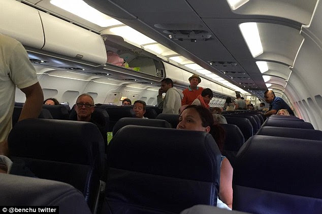 A photo taken by Ben Chu on board the plane where  crew that they could not be served food and drink 'for legal reasons'