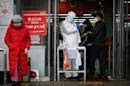 Trump moves to calm virus fears after first death on US soil