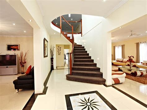 Open plan living room using beige colours with tiles & staircase   Living Area photo 543768