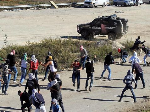 Masked Arabs clash with Israeli security forces  in anti-Israel riot outside the Ofer prison between Jerusalem and  Ramallah.