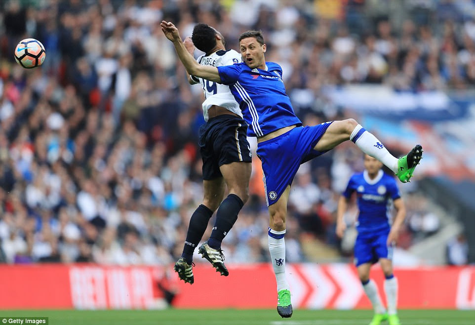 Chelsea midfielder Matic challenges for the ball in the air against opposite number Mousa Dembele