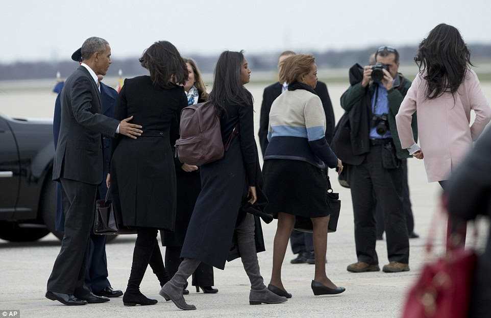 The First Family head to the plane for the first leg of their historic three-day trip as part of efforts to normalize relations with the communist island nation