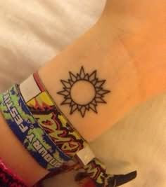 Outline Sun Tattoo On Wrist For Girls