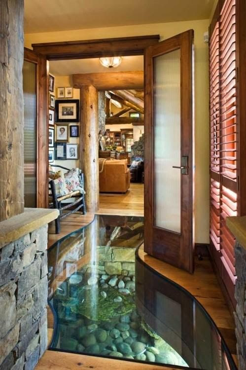 Log home built over a creek with a glass floor for viewing. Might be a problem spot if flooding... pinned with Pinvolve