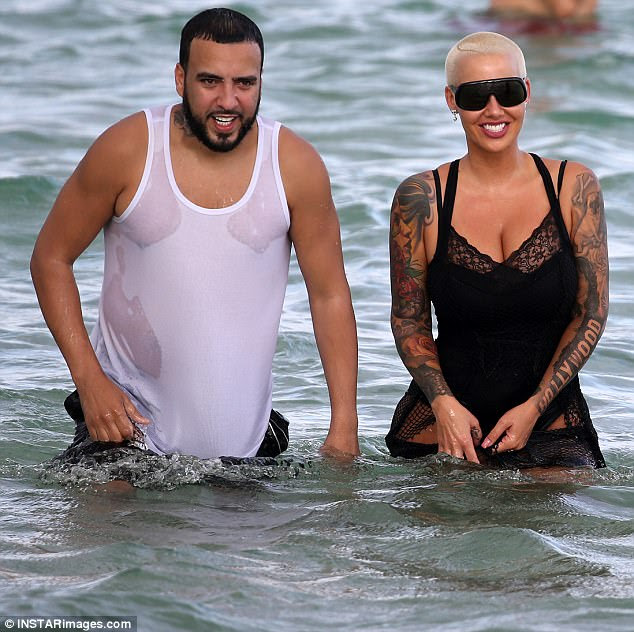 Good times: French and Amber smiled while cooling off in the water