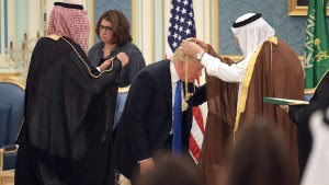 US President Donald Trump (C) receives the Order of Abdulaziz al-Saud medal from Saudi Arabia's King Salman bin Abdulaziz al-Saud (R) at the Saudi Royal Court in Riyadh on May 20, 2017.  / AFP PHOTO / MANDEL NGAN        (Photo credit should read MANDEL NGAN/AFP/Getty Images)
