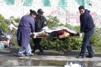 El cadáver de una mujer hallado en Valle de Chalco, Edomex, el 12 de julio de 2011. Foto: David Deolarte