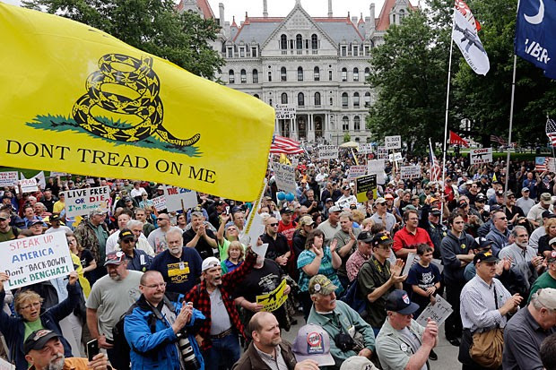 Gun rights activists hold signs during a Second Amendment rally on Tuesday, June 11, 2013, in Albany, N.Y.