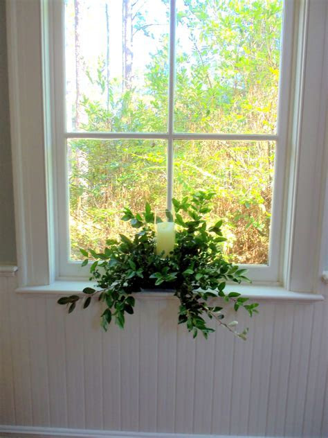 Candles and greenery to accent the church windows
