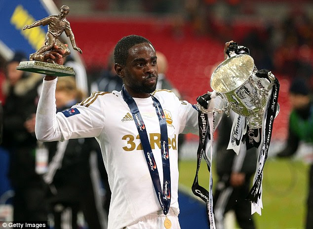 Brace: Two-goal Dyer celebrates with the trophy at Wembley