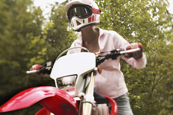 Photo: Person on dirt bike with protective goggles