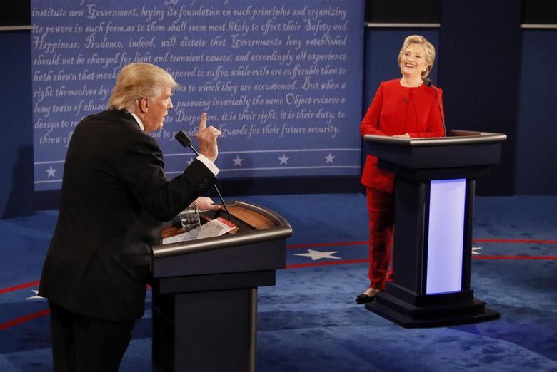 Republican U.S. presidential nominee Donald Trump speaks as Democratic U.S. presidential nominee Hillary Clinton listens during their first presidential debate at Hofstra University in Hempstead, New York, U.S., September 26, 2016.              REUTERS/Rick Wilking