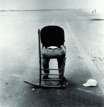Man in empty chair
