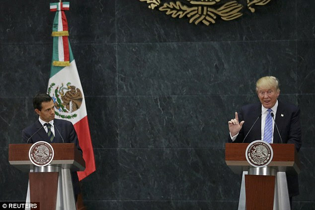 Donald Trump (right) shocked the political world with an impromptu trip South of the border to meet with Mexico's President Enrique Peña Nieto today in Mexico City