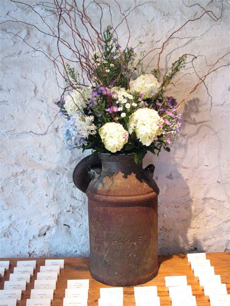 old milk can; different flowers, cute idea though could be