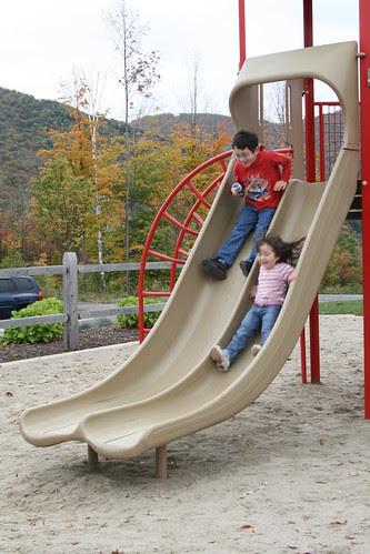 Sliding down the slide together