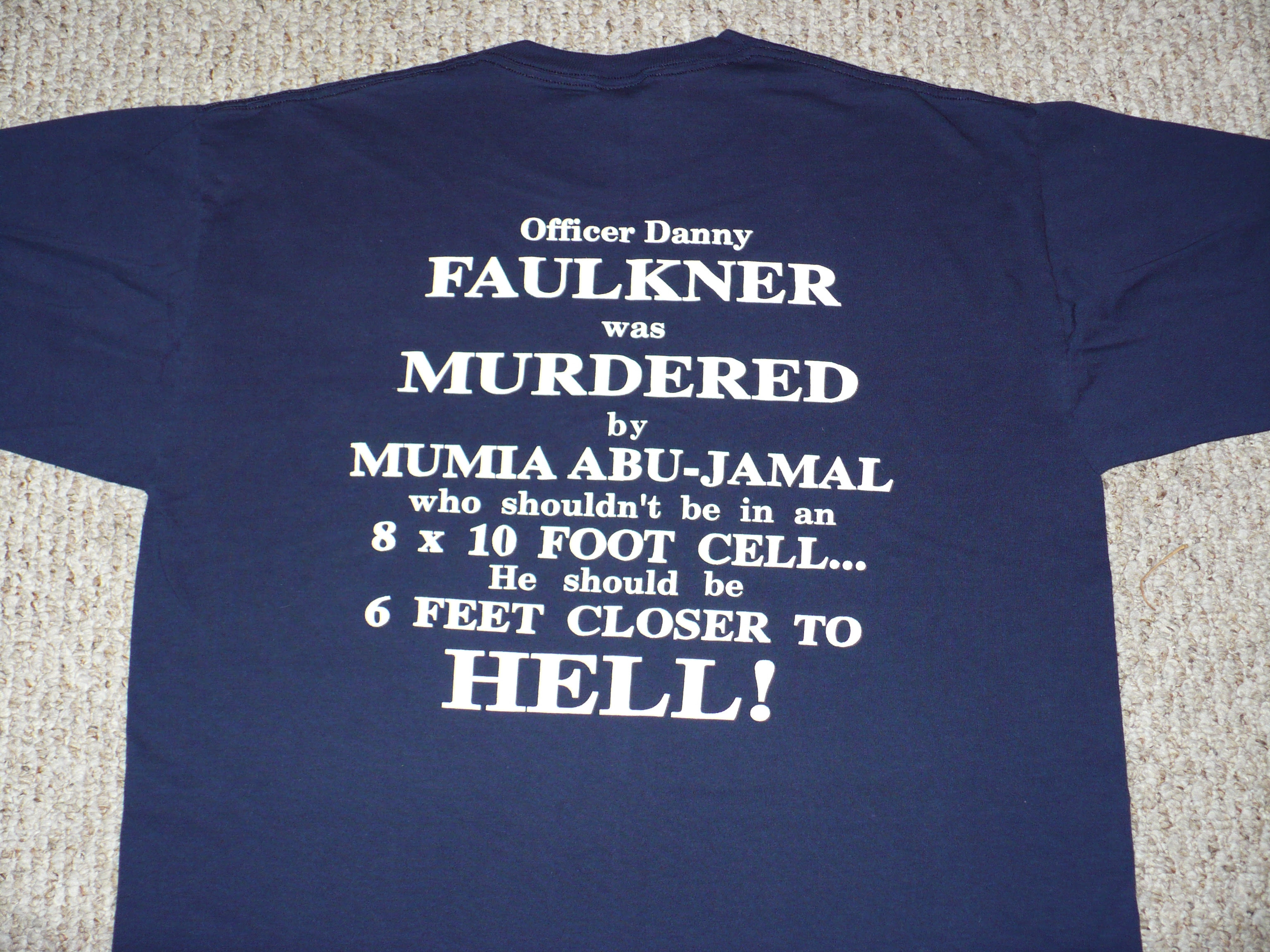 http://upload.wikimedia.org/wikipedia/en/e/e8/Photo_of_anti_Mumia_Abu_Jamal_T-Shirt.JPG