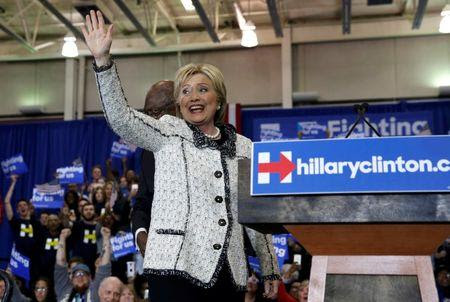 Democratic U.S. presidential candidate Hillary Clinton waves to supporters as she arrives at her South Carolina primary night party in Columbia
