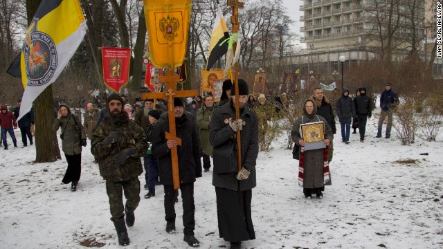 Orthodox believers, carrying icons and crosses, walk during a religious procession outside the parliament building in Kiev, Ukraine, on Friday, December 6.