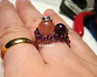 Adjustable wire wrapped Garnet Ring around my finger