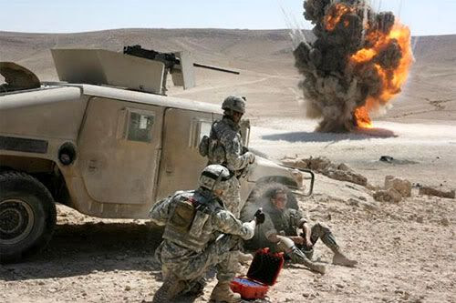 An explosive device is detonated as U.S. soldiers look on in THE HURT LOCKER.