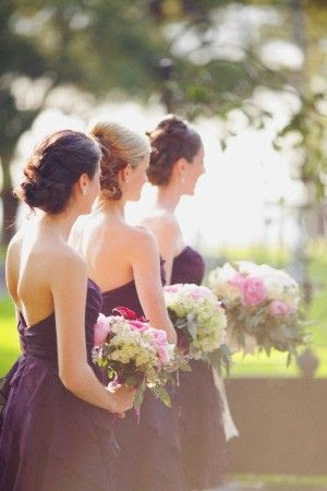 Light variations of pink, white and green flowers contrasts well with grape-colored bridesmaids dresses. #weddingwednesday