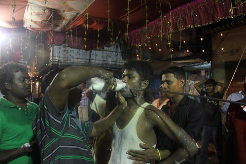 Milk To Lubricate The Mouth And The Rod Within For Easy Removal.. by firoze shakir photographerno1