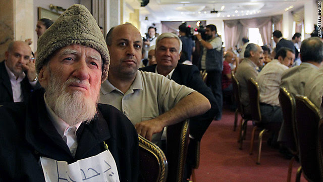 Muslim cleric Jodat Said, left, sits in on a public conference on democratic reform in Syria on Monday.