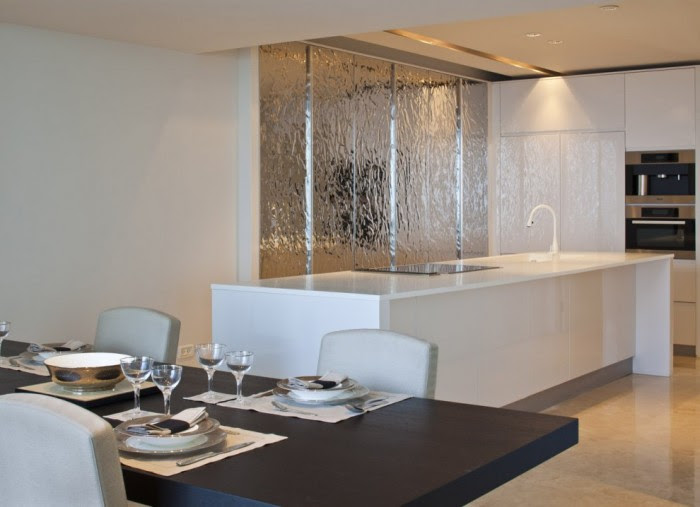 White kitchen island silver feature wall