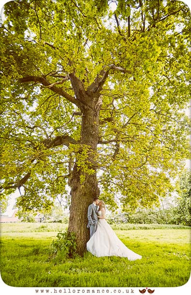 Bride and groom under large tree, Suffolk - www.helloromance.co.uk