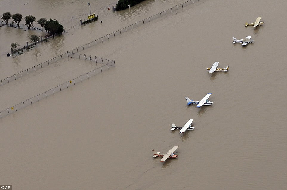 Planes in an airfield near the Addicks Reservoir on Tuesday after more flood water came cascading down