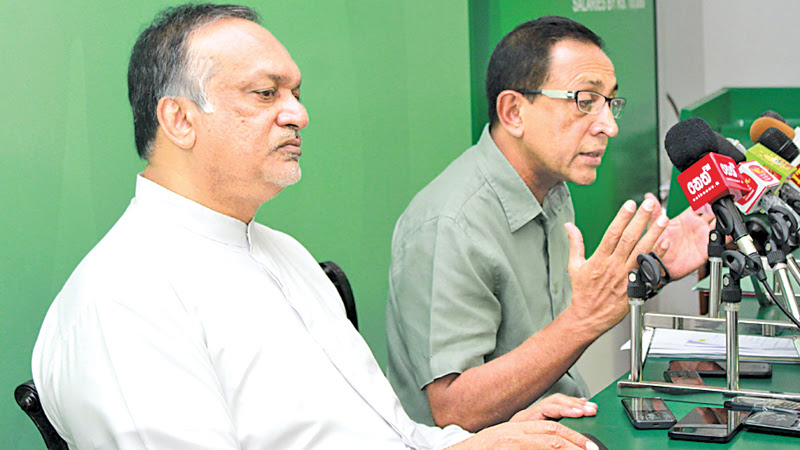 Public Enterprise Development Minister Kabir Hashim and Labour and Trade Union State Minister Ravindra Samaraweera addressing a media briefing at Sirikotha yesterday. Picture by Sarath Peiris