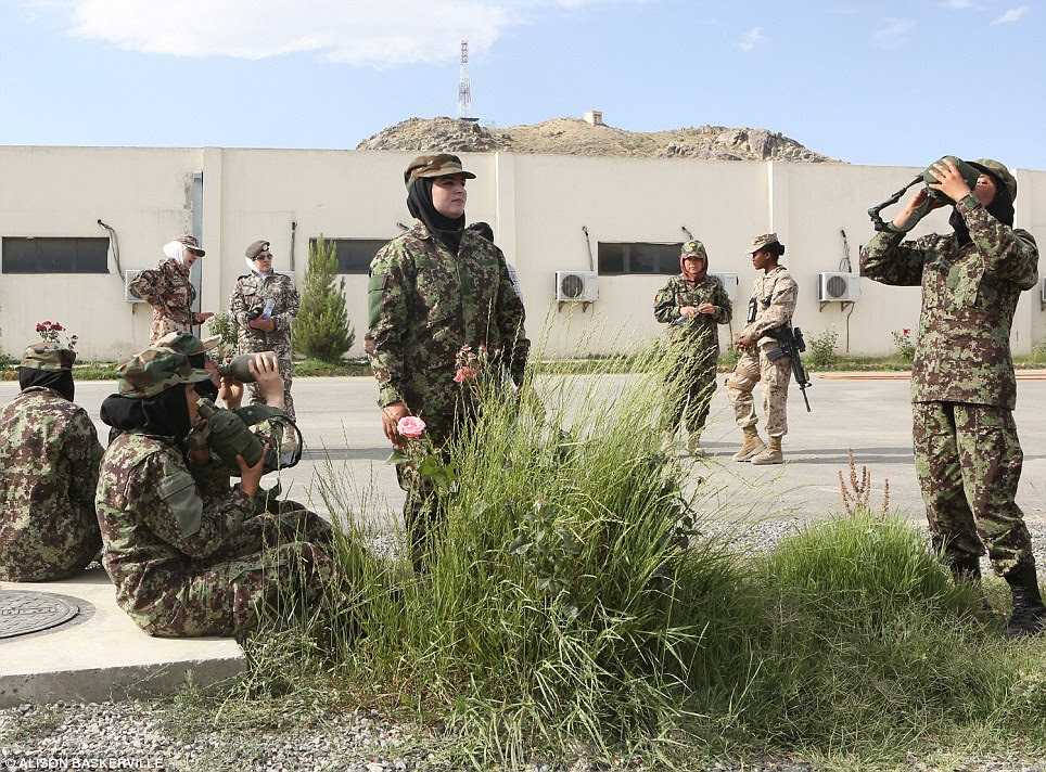 Breaktime: The women take a break after practising their marching skills. Although the training takes place in a separate facility to the men, they are pushing for the women to graduate alongside the male soldiers