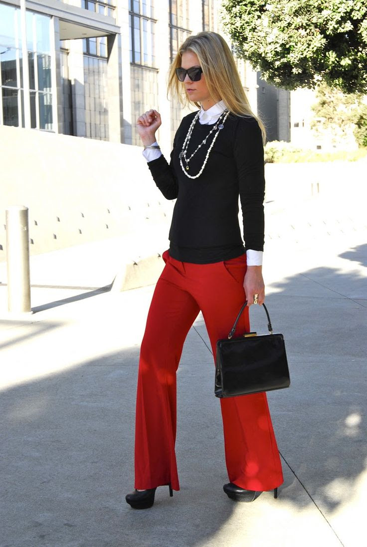 WIDE LEG PANTS in red with black cardigan, white blouse and chain necklaces